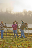 Photographers watching for, photographing and pointing at Bald Eagles in Skagit River area