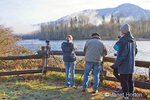 Photography group watching for and photographing Bald Eagles at the mile marker 100 pullout on highway 20 in Skagit River area