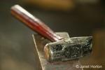 Blacksmith's hammer sitting on the anvil, taken in the Blacksmith Shop