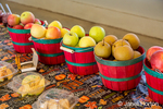 Rome, Winter Banana, Golden Delicious apples and Asian Hosui pears for sampling at a fruit stand.