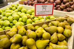 Bosc, Anjou and Taylor's Gold pears for sale at a fruit stand.