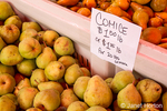 Comice pears for sale at a fruit stand.