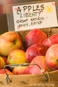 Organic Liberty apples in a bushel basket at a farmer's market taken at Fall City Farms
