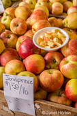 Jonaprince apples available for tasting and purchase at a fruit stand.