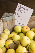 Heirloom Fuji apples for sale at a fruit stand.