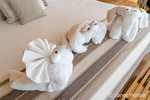 Towel-folding art creations of a snail, crab and elephant.