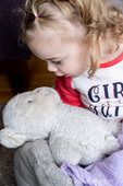 "22 month old girl talking to her stuffed lamb, telling it to go ""night night"""