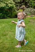 Issaquah, Washington, USA.  18 month old girl having fun exploring a backyard.  (MR)