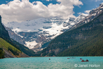 Banff National Park, Alberta, Canada.  People canoeing on Lake Louise.  (For editorial use only)