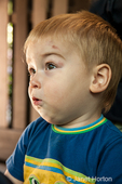 Seattle, Washington, USAToddler boy with scratched up face, unsure what his Mom is asking him to do.  (MR)