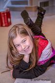 Ten year old girl lying on the floor.  (MR)