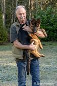 "Issaquah, Washington, USA.  Man holding his four month old German Shepherd puppy ""Lander""."