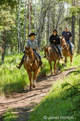 People horseback riding on the Patricia Lake Circle trail near Jasper, Jasper National Park, Alberta, Canada.  (For editorial use only)