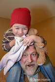 Issaquah, Washington, USA.  Three year old boy sitting on his Grandpa's shoulders.