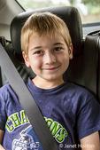 Seattle, Washington, USA.  Seven year old boy wearing a seatbelt in a car. (MR)
