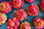 Homemade cupcakes with decorative frosting.