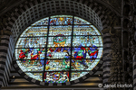 Siena, Italy.  Stained glass rose window depicting the Last Supper in the Cathedral of Santa Maria Assunta.