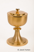 Gold chalice or ciborium with lid used at St. Joseph Catholic Church