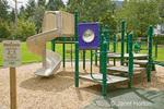 Preschool playground equipment in small, neighborhood playground aimed at children 2 - 5 years of age