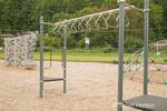 Elementary school-age playground equipment (swinging metal monkey bars,  in Issaquah, WA