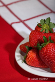 Plate of whole strawberries