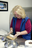 Woman (Cindy) shaping chevre cheese into a log shape