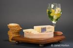 Gruyere Swiss cheese, glass of wine and crackers