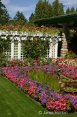 Formal garden with trellis of flowers in Butchart Gardens