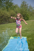 4 year old Audrey running on the Slip N Slide