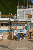 Couple drinking and relaxing on the deck of the Oosterdam Holland America cruise ship