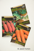 Organic broccoli, beet and carrot seed packets.  Note that brand name has been cloned out.