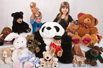 Collection of stuffed animals with 2 year old boy, Joshua, holding up his teddy bear, and his 5 year old sister, Joanna
