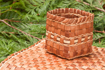 Hand-woven mat and basket made from the pliant inner bark of a Western Red Cedar tree