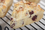 Home made cranberry, lemon and almond scones on a cooling rack