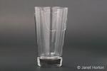 Broken glass tumbler with a large crack