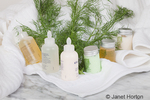 Fennel plant, along with bottles and jars of shampoo, conditioner, etc., in a spa setting for aromatherapy