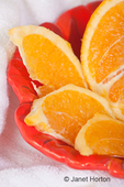Bowl of orange slices and orange half in a spa setting for aromatherapy purposes