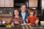 Grandmother, Sue and granddaughters, Islay & Matisse, making cookies