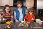 Grandmother, Sue and granddaughters, Islay & Matisse, making cookies
