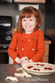 Four year old girl, Islay, happy with the cherry pie she helped make which is now ready to bake