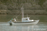 Fishing boat with fisherman waving