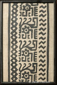 An African fabric strip created using block printing made with print blocks covered with black paint and printed in sequence