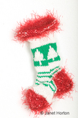 Knitted Christmas stocking with a Christmas tree pattern and red fluffy trim