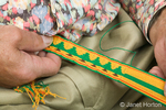 Close-up of card-woven belt being made by a man, Robert, in his home