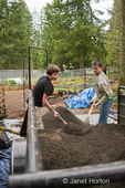 Teenage boys (Wes and Robert) shoveling veggie mix dirt for community garden usage in western WA