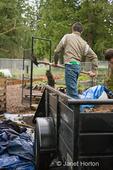 Teenage boys (Wes and Robert) shoveling veggie mix dirt for community garden usage
