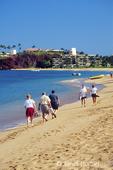 Men and women walking on the beach