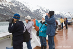 People on board the Oosterdam cruise ship observing the Marjorie Glacier and whale watching