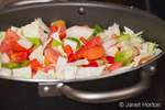 Stock pot of raw ingredients (bell peppers, onions, cabbage, carrots and green tomatoes) for making relish
