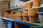 Small, local, independent hardware store shelves of clay pots and compost at Madison Park Hardware store